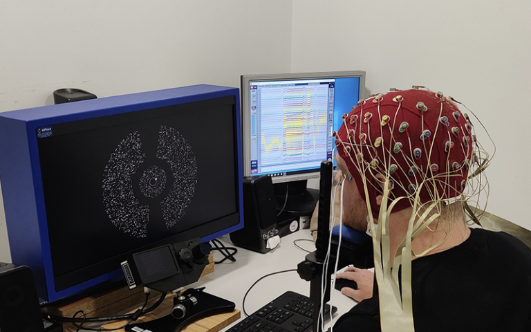 A participant undertakes a visual attention experiment with an EEG attached at the Queensland Brain Institute.